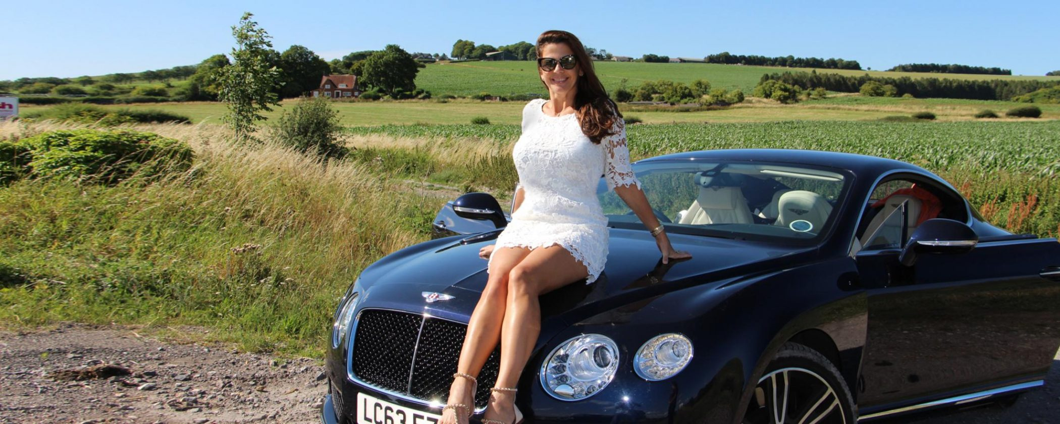Fancy and elegant woman with her luxury car in the UK, by Omnimundi