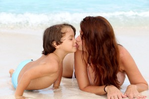 Mother and Son from Omnimundi Family kiss on a Beach