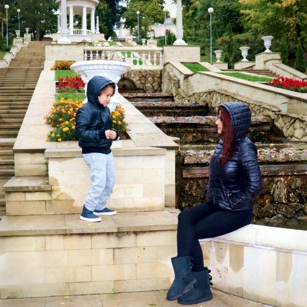 Mother and son playing in a rainy day in Chisinau, the capital of Moldova, by Omnimundi