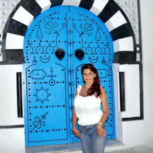 Mrs Omimundi standing at the famous Blue Door in Tunisia