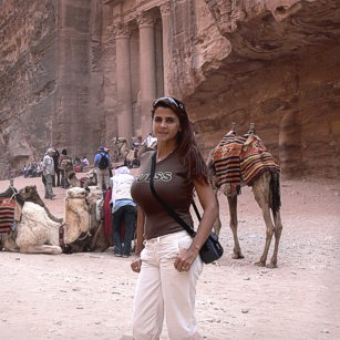 Beautiful traveler woman in the ruins of Petra by Omnimundi