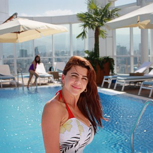 The Omnimundi gorgeous lady in bikini inside the four seasons hotel during her travel to Lebanon