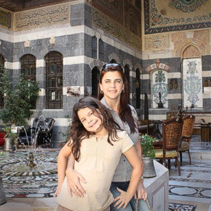 Mother and daughter visits a luxury hotel in Damascus during a short travel to Syria