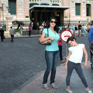Mother and daughter (tourists) in Ho Chi Minh in front of the Post Office