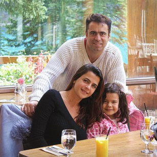 Omnimundi family having breakfast inside a luxury lake border hotel in Canada