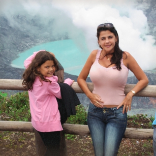 a Woman and her daughter visiting a volcano crater in Costa Rica during a travel to Central Americast