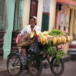 A man selling tropical fruits in the streets of Santo Domingo in Dominican Republic