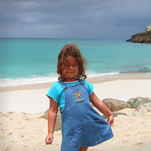 A young girl on a gorgeous beach in St. Marten in French Antilles