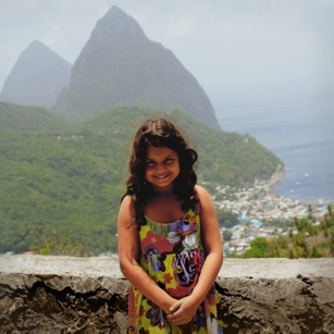 Young tourist posing in the city of Soufriere near the famous Pitons in Saint Lucia