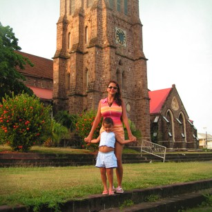 Omnimundi Family in front of a church in St. Kitts capital in the Caribean