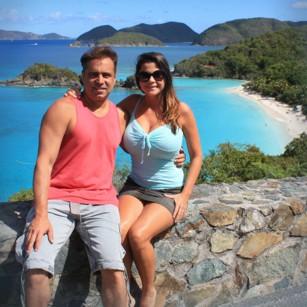 Elegand tourists standing in Trunk Bay in US Virgin Islands