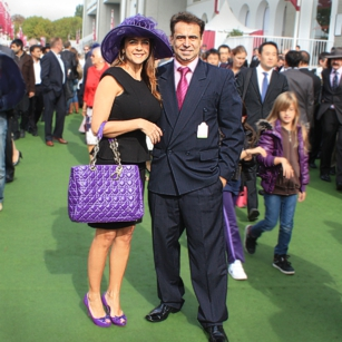 Well dressed Omnimundi Couple attending a luxury party in Longchamps race course in Paris