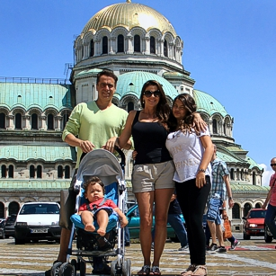 Omnimundi Familly standing in front of a Church in Sofia Bulgaria