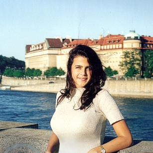 Woman in the board of Vltava river in Prague