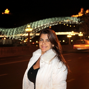 A beautiful woman posing by nigh near a bridge in Tblisi Georgia by Omnimundi