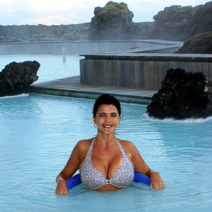 A woman in grey Bikini inside a pool in a luxury hotel in Iceland, by omnimundi