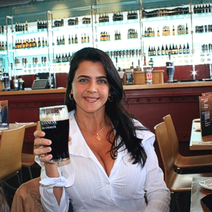 Mrs Omnimundi beauty having a Guinness bear in a restaurant during her travel in Dublin, Ireland