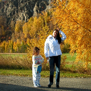 Norway during the falls, by omnimundi showing a woman, a girl and a yellow tree