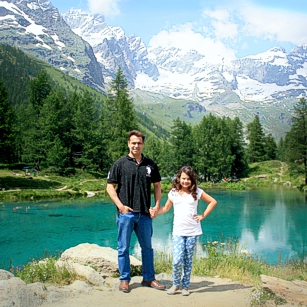 A typical Swiss landscape with a lake and the Matterhorn in the back ground featuring the Omnimundi Family