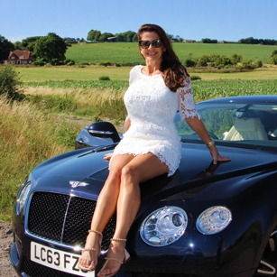 Omnimundi woman sitting on a luxury car in United Kingdom countryside