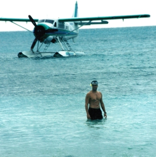 A tourist comming out of his luxury Sea Plane in Green Island in Australia