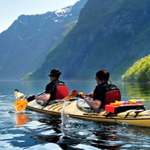 Two guys paddling a Kayak during an adventure travel