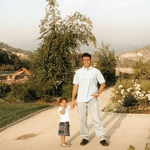 Father and young daughter walk near Santiago in Chile