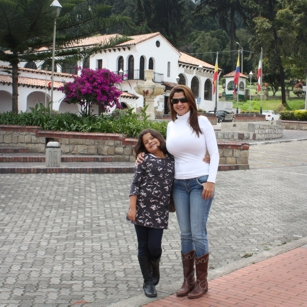 Mother and daughter with an old house in back ground in Zipaquira Colombia by Omnimundi Travel