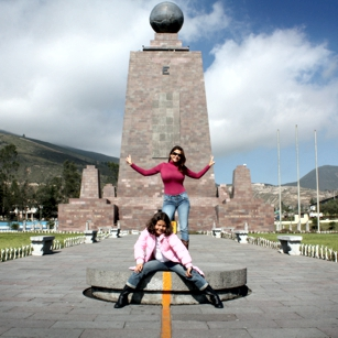 People standing on the mark zero point on equator line in Quito, Ecuador