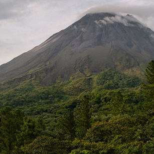A huge Volcano covered by forests in a cloudy day